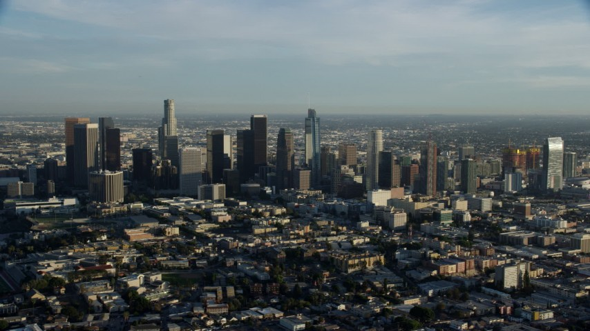 8K stock footage aerial video flying by the skyscrapers in Downtown Los Angeles, California Aerial Stock Footage | AX0162_024