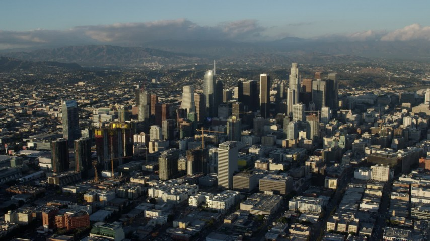 8K stock footage aerial video of skyscrapers in Downtown Los Angeles, California surrounded by city sprawl Aerial Stock Footage | AX0162_038