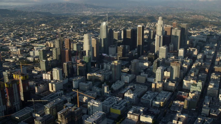 8K aerial video approaching the skyscrapers in Downtown Los Angeles, California from southwest of the city Aerial Stock Footage | AX0162_039