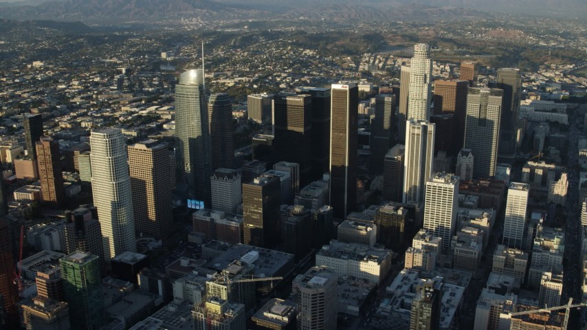 8K stock footage aerial video flying over Downtown Los Angeles, California to approach Aon Center Aerial Stock Footage | AX0162_040