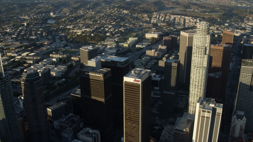 8K stock footage aerial video flying over Aon Center and approach heavy 110 traffic in Downtown Los Angeles, California Aerial Stock Footage | AX0162_041