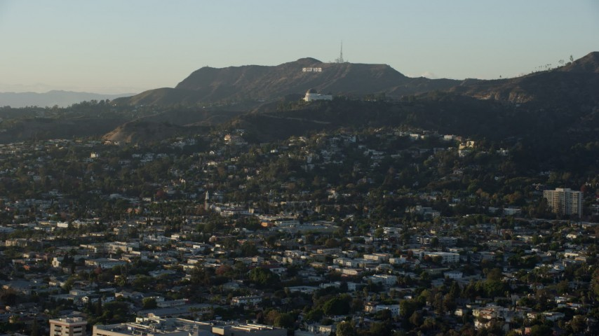 8K stock footage aerial video flying over Los Felix to approach Hollywood Sign and Griffith Observatory in Los Angeles, California Aerial Stock Footage | AX0162_046