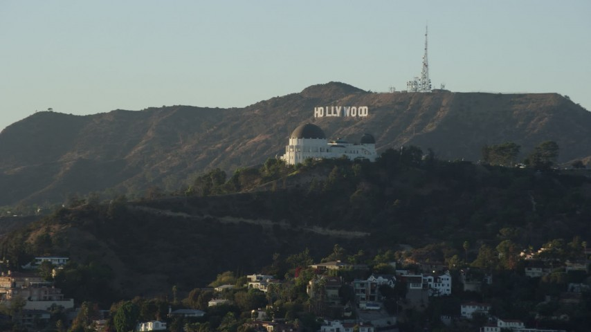 8K stock footage aerial video of the Hollywood Sign behind Griffith Observatory in Los Angeles, California Aerial Stock Footage | AX0162_048