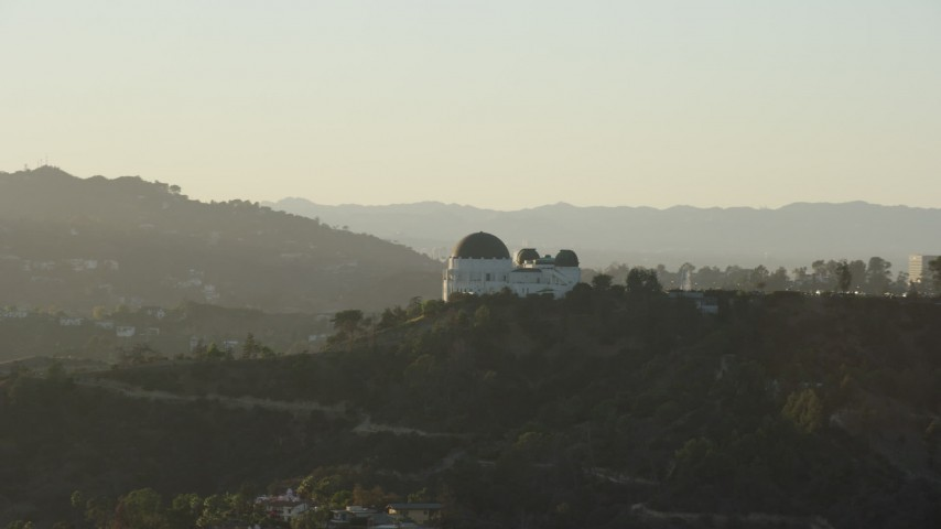 8K stock footage aerial video orbiting Griffith Observatory in Los Angeles, California Aerial Stock Footage | AX0162_051