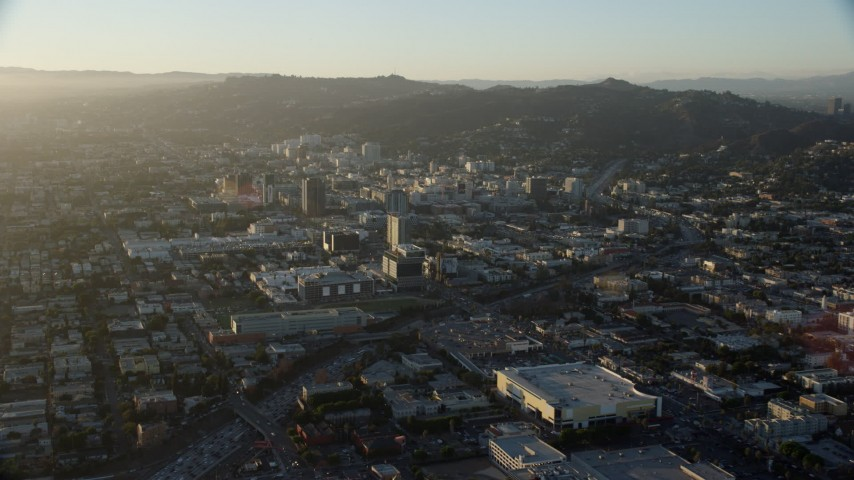 8K stock footage aerial video approaching office buildings in Hollywood, California Aerial Stock Footage | AX0162_054