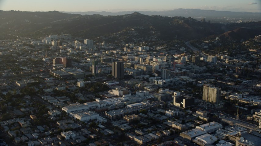 8K stock footage aerial video flying by office buildings in Hollywood, California Aerial Stock Footage | AX0162_056