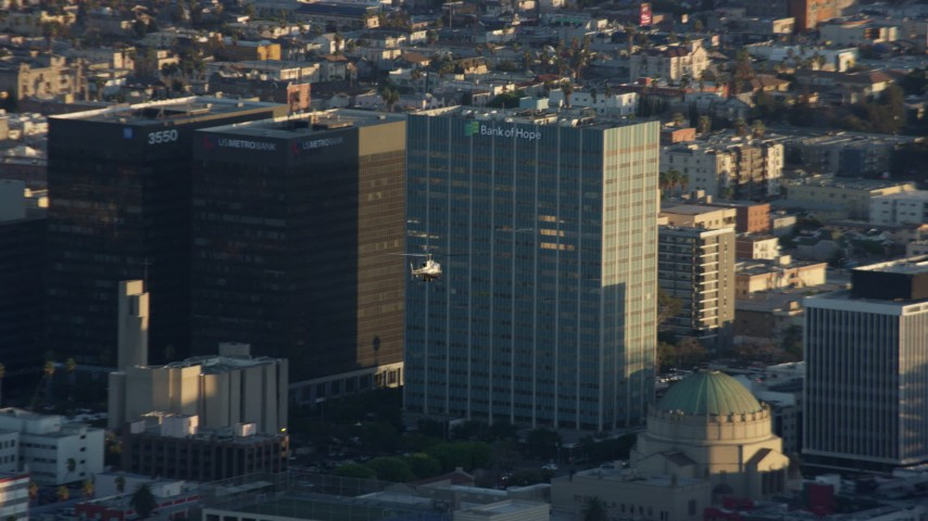 8K stock footage aerial video of an LAPD helicopter flying over Koreatown, Los Angeles, California Aerial Stock Footage | AX0162_058