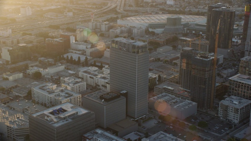 8K stock footage aerial video approaching Transamerica Center at sunset in Downtown Los Angeles, California Aerial Stock Footage | AX0162_067