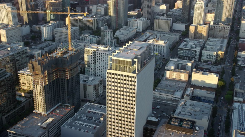 8K stock footage aerial video orbiting Transamerica Center at twilight in Downtown Los Angeles, California Aerial Stock Footage | AX0162_068