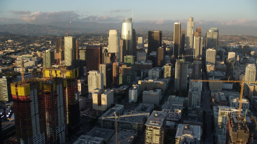 8K stock footage aerial video of skyscrapers seen from Oceanwide Plaza at sunset in Downtown Los Angeles, California Aerial Stock Footage AX0162_069 | Axiom Images