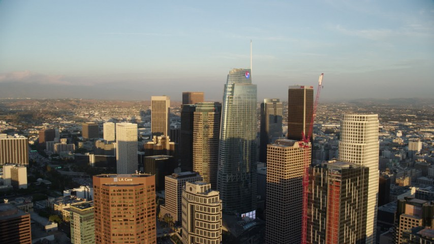 8K aerial video flying by Wilshire Grand Center and skyscrapers at sunset in Downtown Los Angeles, California Aerial Stock Footage | AX0162_071