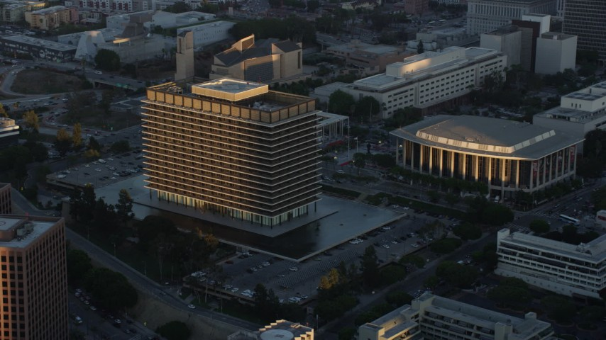 8K stock footage aerial video approaching LADWP office building at twilight in Downtown Los Angeles, California Aerial Stock Footage | AX0162_072