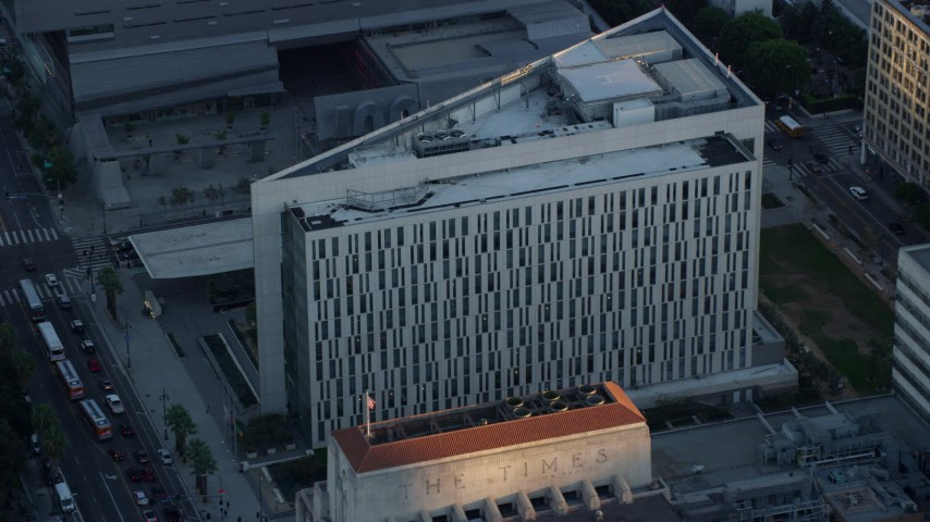 8K stock footage aerial video approaching the LAPD headquarters at twilight in Downtown Los Angeles, California Aerial Stock Footage | AX0162_073