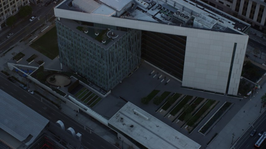8K stock footage aerial video orbiting the LAPD headquarters at twilight in Downtown Los Angeles, California Aerial Stock Footage | AX0162_074