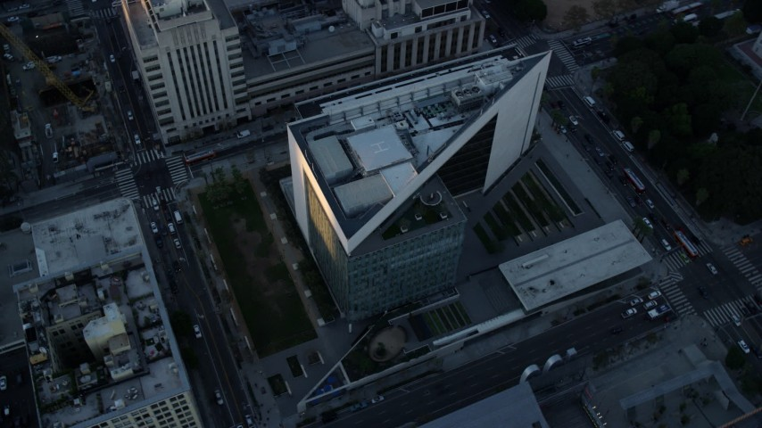 8K aerial video of a reverse view of LAPD headquarters at twilight, revealing city hall in Downtown Los Angeles, California Aerial Stock Footage | AX0162_078