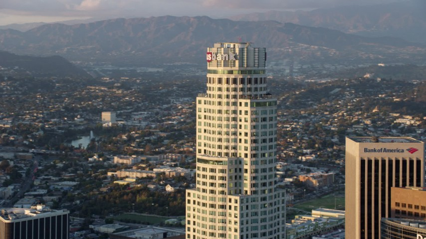 8K stock footage aerial video orbiting US Bank Tower at sunset in Downtown Los Angeles, California Aerial Stock Footage | AX0162_079