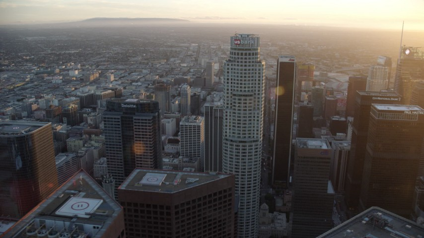 8K stock footage aerial video orbiting of US Bank Tower at sunset in Downtown Los Angeles, California Aerial Stock Footage | AX0162_082