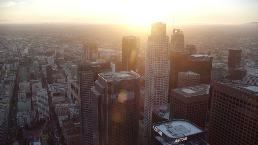 8K stock footage aerial video orbiting of US Bank Tower and skyscrapers at sunset in Downtown Los Angeles, California Aerial Stock Footage | AX0162_083