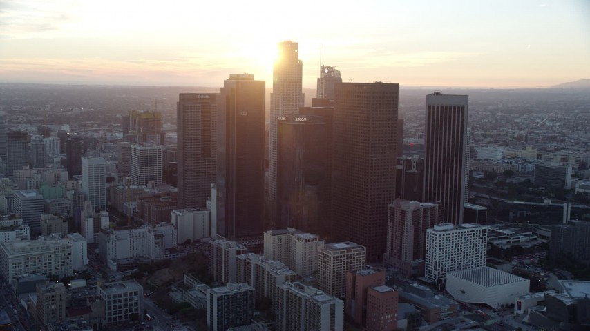 8K stock footage aerial video orbiting the tall skyscrapers of downtown at sunset in Downtown Los Angeles, California Aerial Stock Footage | AX0162_087