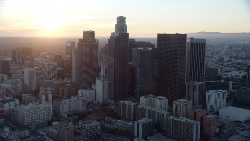 8K stock footage aerial video orbiting tall skyscrapers of downtown at sunset in Downtown Los Angeles, California Aerial Stock Footage | AX0162_088
