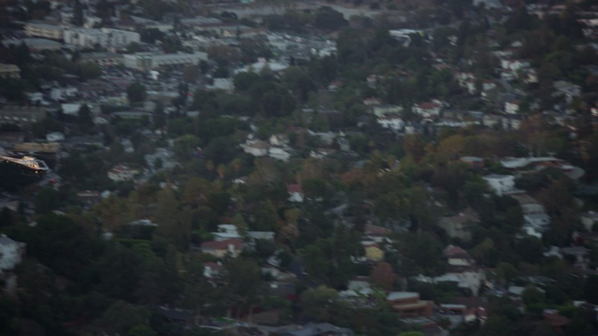 8K stock footage aerial video tracking an LAPD helicopter flying over Silver Lake, twilight, Los Angeles, California Aerial Stock Footage | AX0162_091