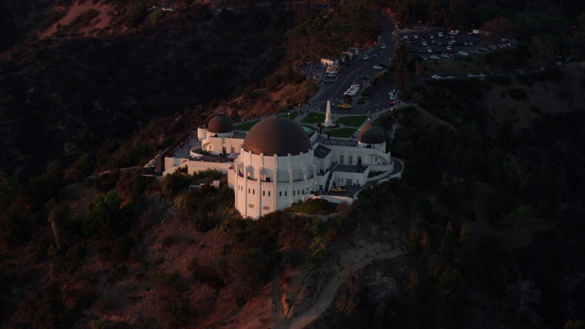 8K stock footage aerial video approaching Griffith Observatory in Los Angeles, California at twilight Aerial Stock Footage | AX0162_099