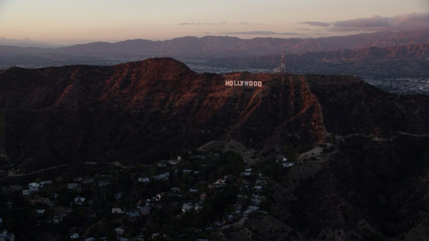 8K stock footage aerial video of the Hollywood Sign in Los Angeles, California at twilight Aerial Stock Footage | AX0162_100