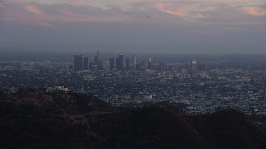 8K stock footage aerial video of Downtown Los Angeles, California at twilight, reveal Griffith Observatory Aerial Stock Footage AX0162_105 | Axiom Images