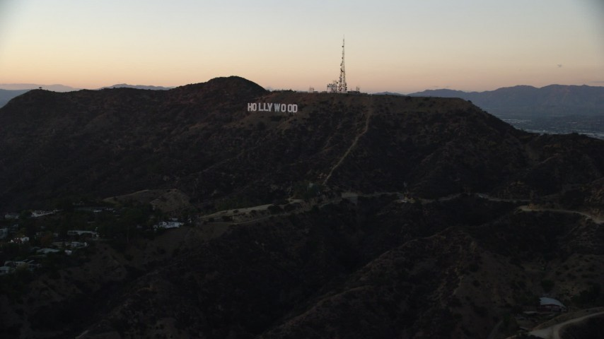 8K stock footage aerial video approaching the famous Hollywood Sign at twilight in Los Angeles, California  Aerial Stock Footage | AX0162_107