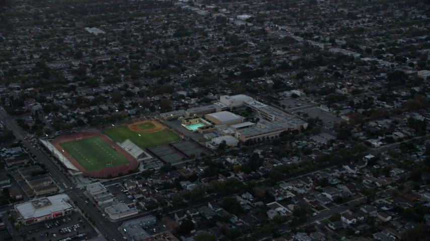8K stock footage aerial video of John Burroughs High School at twilight in Burbank, California  Aerial Stock Footage | AX0162_111