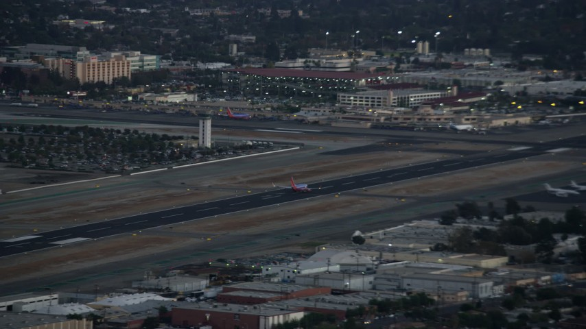 8K stock footage aerial video of a commercial airplane taking off at twilight from Burbank Airport, California  Aerial Stock Footage | AX0162_117