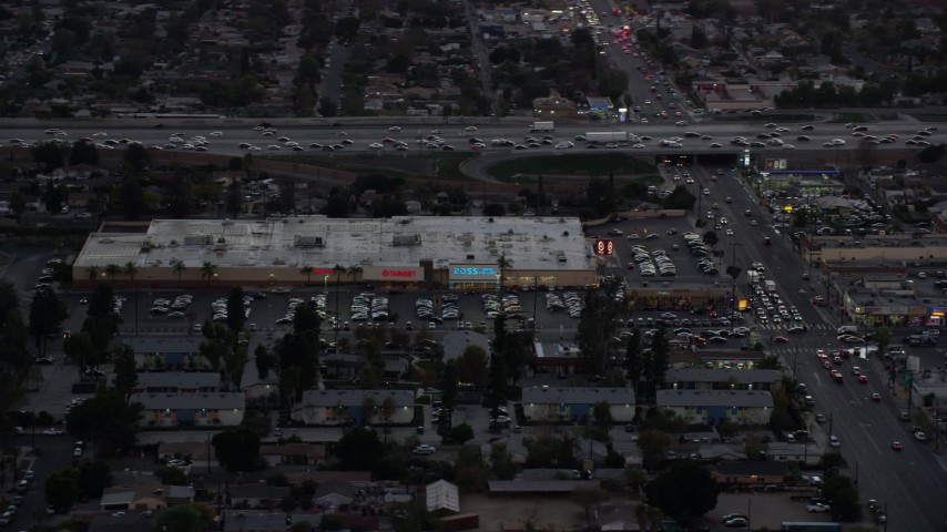 8K stock footage aerial video of Pacoima Center shopping center in Pacoima, California at twilight Aerial Stock Footage | AX0162_120