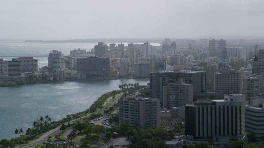 5k Aerial Video of Waterfront Apartment Buildings, San Juan Puerto Rico Raining Aerial Stock Footage | AX101_003