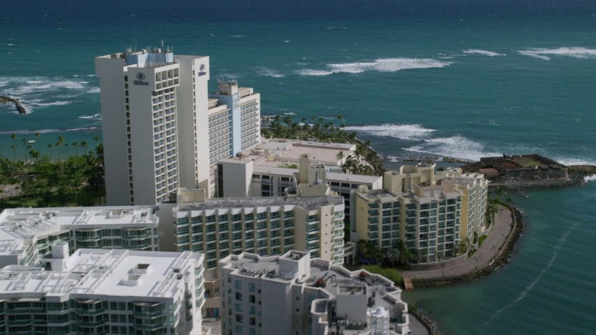 5k Aerial Video of Oceanside Resort Hotel in the Caribbean, San Juan Puerto Rico Aerial Stock Footage | AX101_004