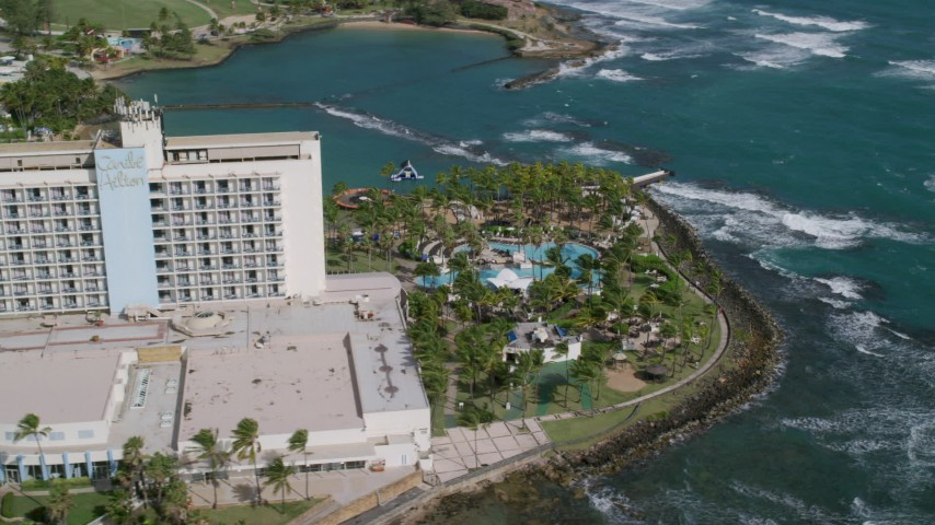 5k Aerial Video of Oceanside Caribbean Resort Hotel and Pool Area, San Juan Puerto Rico Aerial Stock Footage | AX101_005