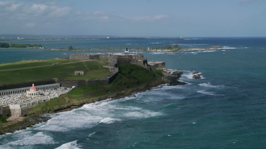 5K stock footage aerial video of a Historic fort along the coast with clear blue water, Old San Juan Puerto Rico Aerial Stock Footage | AX101_011