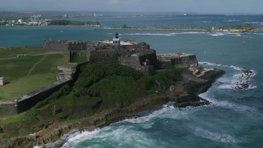 5k Aerial Video of a Historic fort along the coast with clear blue water, Old San Juan Puerto Rico Aerial Stock Footage | AX101_012