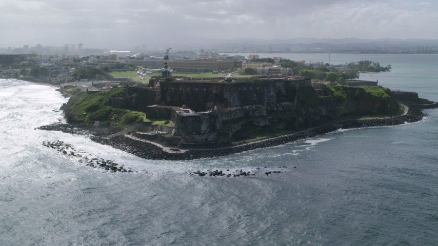 5k Aerial Video of a Historic fort along the coast, Old San Juan Puerto Rico Aerial Stock Footage | AX101_014
