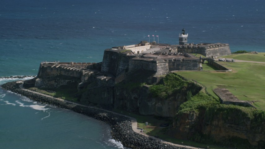 5k Aerial Video of a Historic fort along the coast in the blue waters of the Caribbean, Old San Juan Puerto Rico Aerial Stock Footage | AX101_017