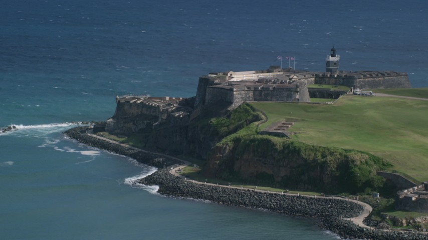 5k Aerial Video of a Historic fort along the coast in the blue waters of the Caribbean, Old San Juan Puerto Rico Aerial Stock Footage | AX101_018