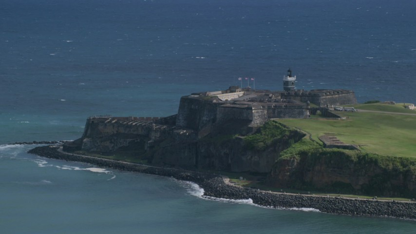 5k Aerial Video of a Historic fort on the coast in the blue Caribbean waters, Old San Juan Puerto Rico Aerial Stock Footage | AX101_019