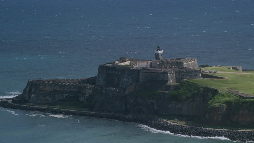 5K stock footage aerial video of a Historic fort on the coast in the blue Caribbean waters, Old San Juan Puerto Rico Aerial Stock Footage | AX101_020
