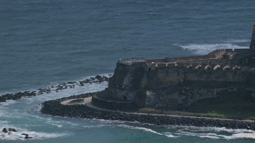 5K stock footage aerial video of a Historic fort on the coast with tourists, Old San Juan Puerto Rico Aerial Stock Footage | AX101_021