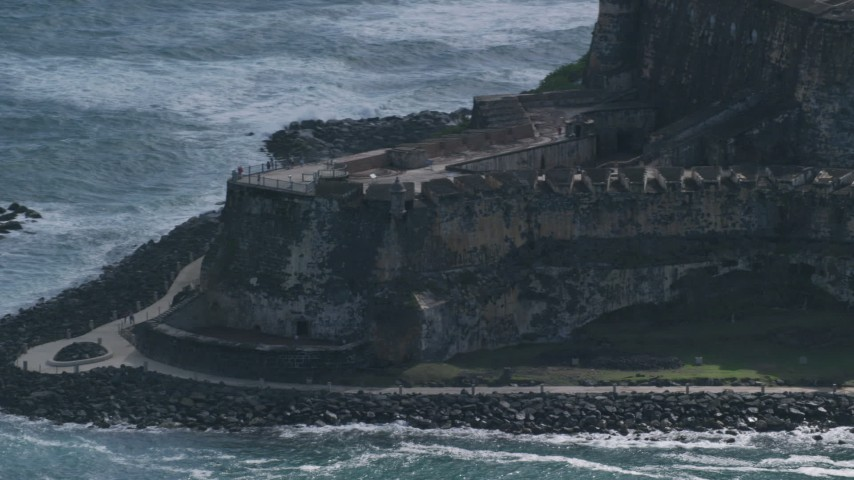 5k Aerial Video of a Historic fort and lighthouse on the coast, Old San Juan Puerto Rico Aerial Stock Footage | AX101_022