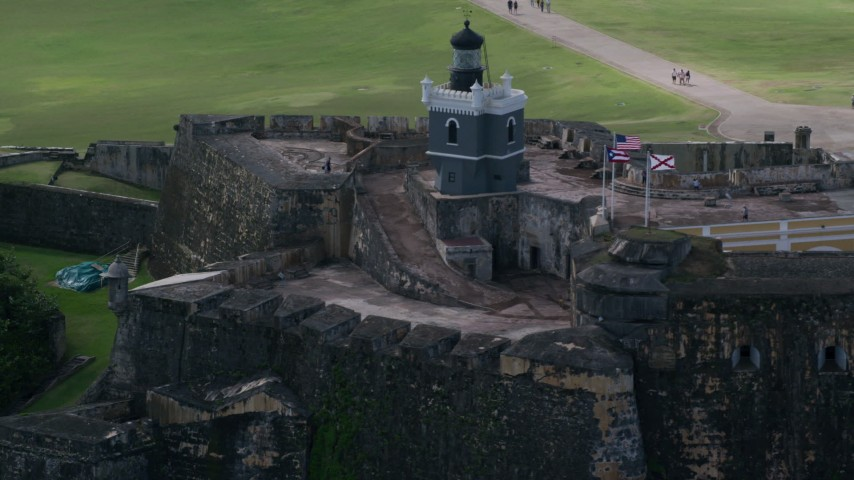 5k Aerial Video of a Historic fort and lighthouse, Old San Juan Puerto Rico Aerial Stock Footage | AX101_024