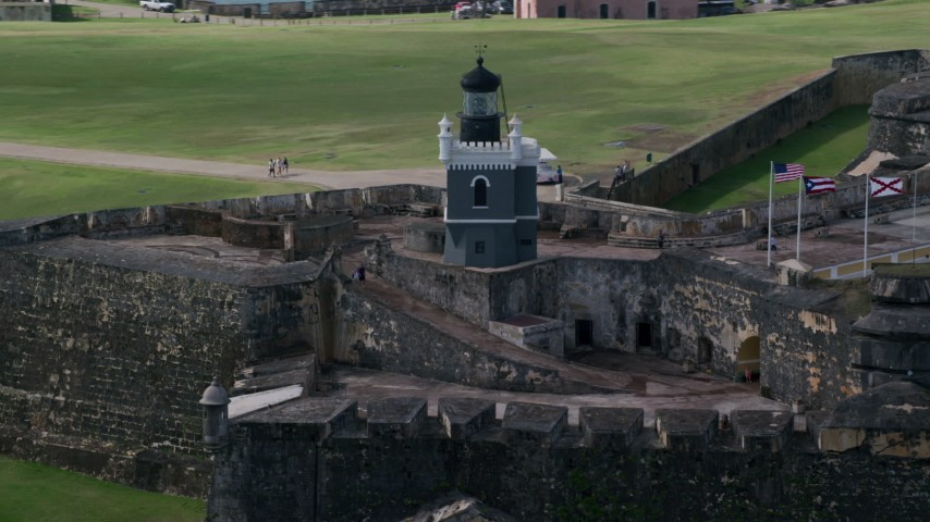 5k Aerial Video of a Historic fort and lighthouse, Old San Juan Puerto Rico Aerial Stock Footage | AX101_025
