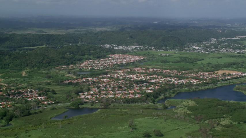5k Aerial Video of Residential neighborhoods among trees and grassy areas, Dorado, Puerto Rico  Aerial Stock Footage | AX101_033