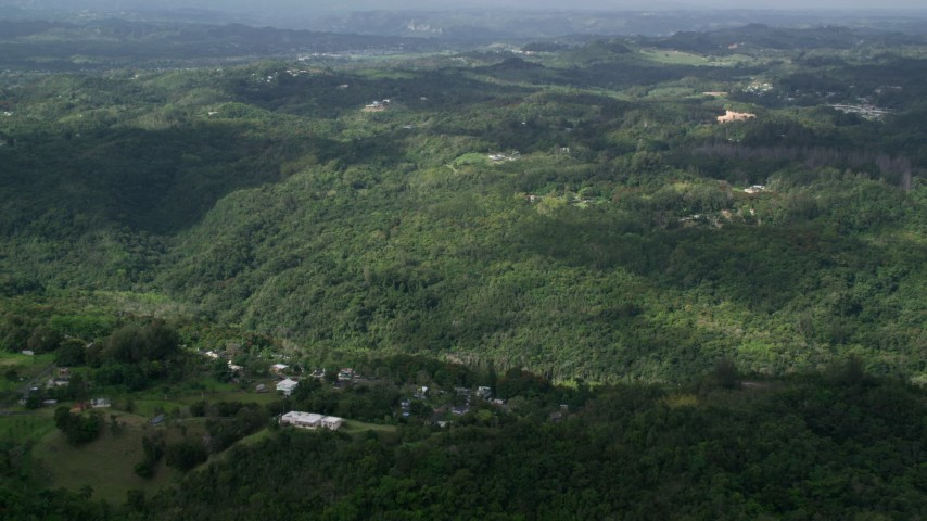5k Aerial Video of Tree covered hills and rural homes, Vega Baja, Puerto Rico Aerial Stock Footage | AX101_040