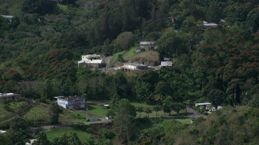 5k Aerial Video of Tree covered hills with rural homes, Vega Baja, Puerto Rico  Aerial Stock Footage | AX101_042