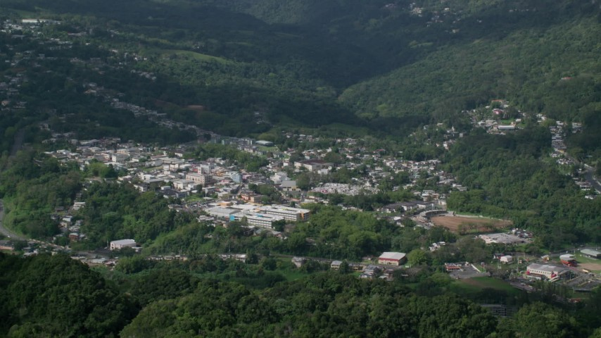 5k Aerial Video of a Town nestled in a valley of trees, Ciales, Puerto Rico  Aerial Stock Footage AX101_046 | Axiom Images